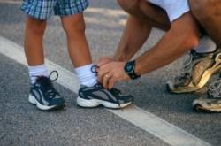 tying his shoe