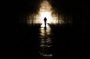 Man Walking Towards Cross