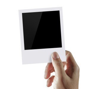 polaroid photo in hand
