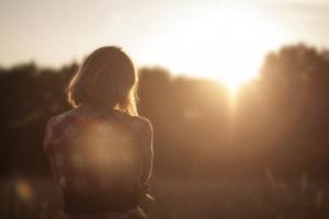 girl watching a sunrise