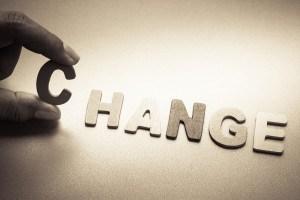 Finger pick wood letters of Change word