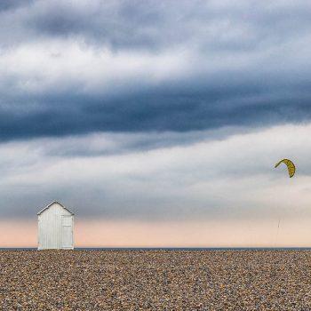 Beach Hut and Kite Surfer