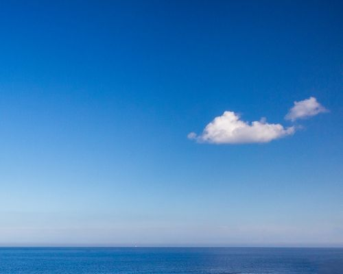 Boat on the horizon (Colour)