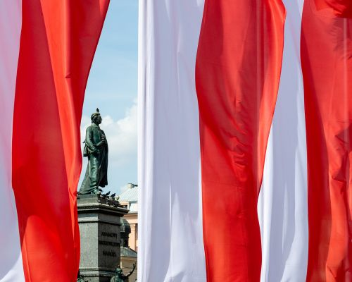 Flags and statue in Krakow