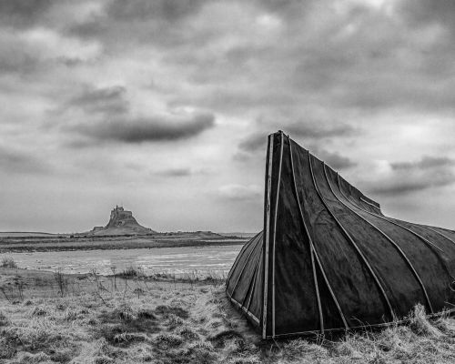 Lindisfarne Castle with traditional shed, made of upturned fishing boats