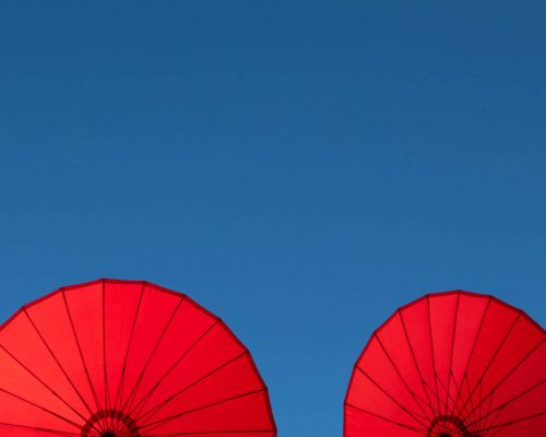 Two red parasols