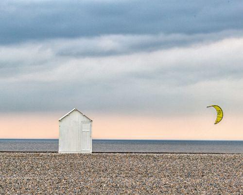 Beach Hut and kite surfer