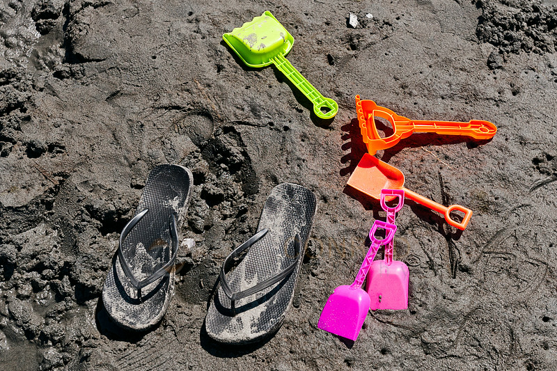 © Paul Conrad/The Bellingham Herald - Sandals and children's shovels lay on the beach during The 31st Annual Birch Bay Sand Sculpture Contest  on Birch Bay Beach on Saturday  morning June 14, 2014, in Birch Bay, Wash.