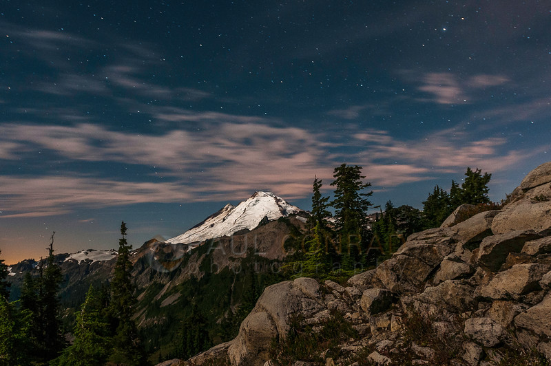 © Paul Conrad/Pablo Conrad Photography - The waning gibbous Moon lights Mt. Baker as the stars leave trails over the volcano as seen from the Table Mountain trail at Artist Point in the Mt. Baker-Snoqualime National Forest in western Whatcom County, east of Bellingham, Wash.