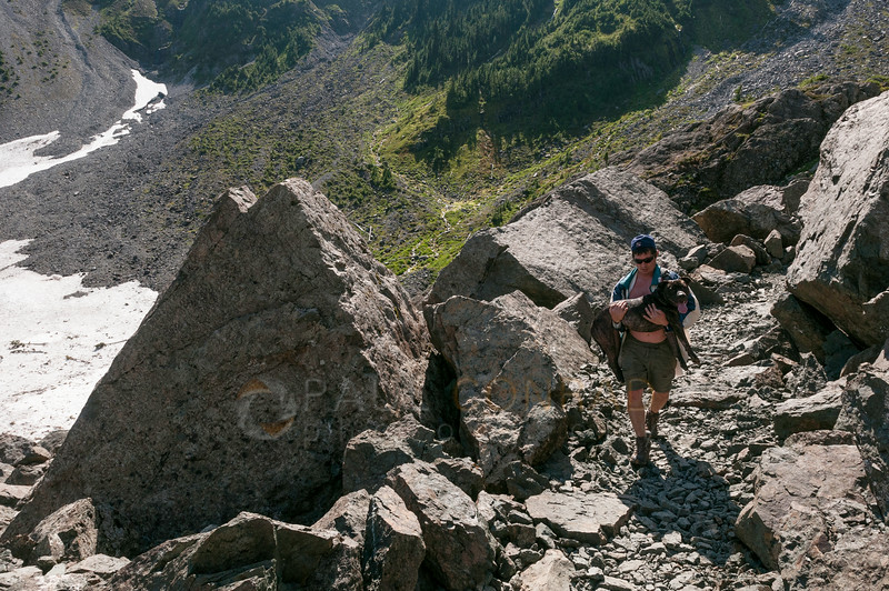 © Paul Conrad/Pablo Conrad Photography - Kurt carries Domino through a rough part of the trail that was covered with sharp rocks.