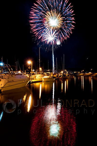 © Paul Conrad/Pablo Conrad Photography - Boats moored at Squalicum Harbor as fireworks explode overhead during Fourth of July celebrations at Zuanich Point Park in Bellingham, Wash., on Thursday July 4, 2013.