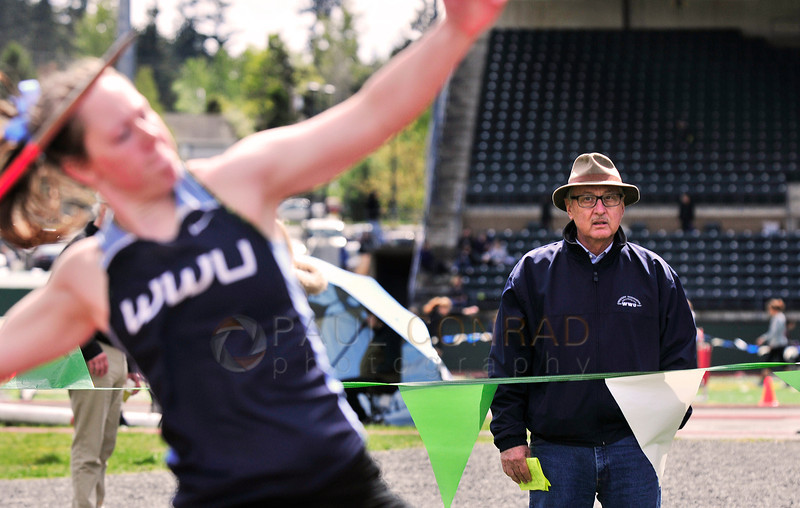 © Paul Conrad/The Bellingham Herald -Retired Western Washington track coach Ralph Vernacchia, right, of Scottsdale, Ariz., observes  WWU sophomore Katie Reichert of Kelso, Wash., compete in the Woman's Javelin during the 2014 Ralph Vernacchia Track and Field Meet at Civic Field in Bellingham, Wash., on Saturday April 26, 2014. The invitiational is named in honor of Vernacchia's long time service. Reichert took 2nd place in the competition.