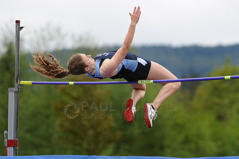 """© Paul Conrad/The Bellingham Herald - Western Washington sophomore Katelyn Wright of Washougal, Wash., clears the bar at 5' 3.75"""" to win the Women's High Jump during the 2014 Ralph Vernacchia Track and Field Meet at Civic Field in Bellingham, Wash., on Saturday April 26, 2014."""