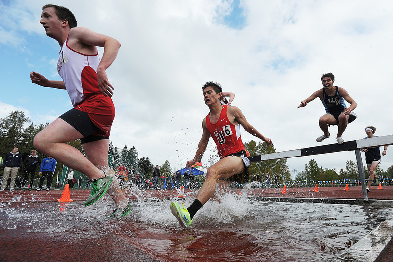© Paul Conrad/The Bellingham Herald - Olympic College's Keith Ryan, left leads Seattle University's Nathan McLaughlin and Western Washington University's Noah Ripley as they tackle the Men's 3000m Steeplechase during the 2014 Ralph Vernacchia Track and Field Meet at Civic Field in Bellingham, Wash., on Saturday April 26, 2014. McLaughlin came in fourht with a time of 9 min. 42.72 seconds. Western Washington's Matt Lutz won the event with the time 9:24.95 with WWU's Joshua Reitner on his heels earning second with a time of 9 min. 38.58 seconds.