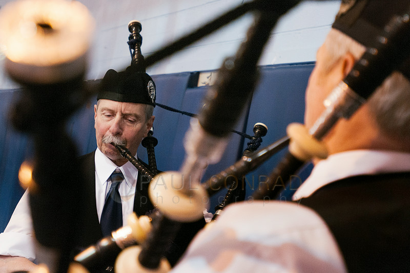 © Paul Conrad/The Bellingham Herald - Bellingham Pipe Band members Gary Griffiths, left, and Peter Rolstad play as graduating students file in during commencement services in Carver Gymnasium at Western Washington University  on Saturday  morning June 14, 2014, in Bellingham, Wash.