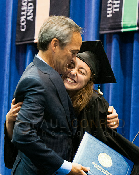 © Paul Conrad/The Bellingham Herald - Hannah Thomas of Bellevue, Wash., hugs her dad Ed Thomas after receiving her diploma during commencement services for graduating Western Washington University students in Carver Gymnasium at Western Washington University  on Saturday  morning June 14, 2014, in Bellingham, Wash.