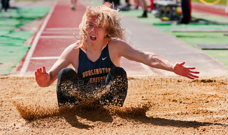 © Paul Conrad/ Pablo Conrad Photography - Burlington-Edison's Luke Tackett lands in the pit during the first Flight of the boy's long jump at the NWC track & field meet at Civic Field and Stadium in Bellingham, WA. Tackett did not qualify for the finals.