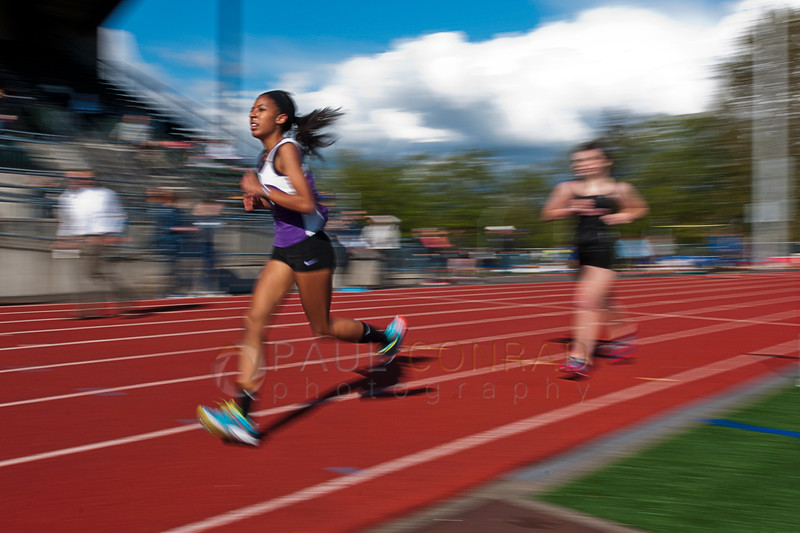 © Paul Conrad/ Pablo Conrad Photography - Anacortes High School senior Grace Dzieciuch battles her second lap in the Girl's 3200 Meter Run during the NWC track & field meet at Civic Field and Stadium in Bellingham, Wash. Dzieciuch finishied in 13th with a time of 12m51.7s.