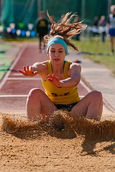 © Paul Conrad/ Pablo Conrad Photography - Burlington-Edison High School senior Megan Wilburg of Burlington, Wash,. lands in the pit during her attempt at the long jump during the NWC Track & Field competition at Civic Field in Bellingham. Wilburg ended fifth overall with a distance of 15 feet 8.75 inches.
