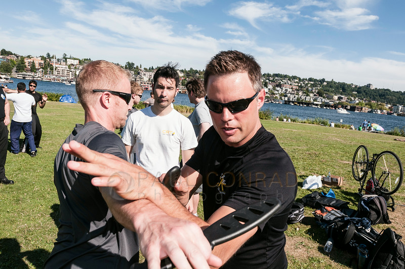 © Paul Conrad/Pablo Conrad Photography - Sifu Cory Walken, right, with Seattle Close Range Tactics demonstrates proper defensive techniques at Gasworks Park in Seattle, Wash.
