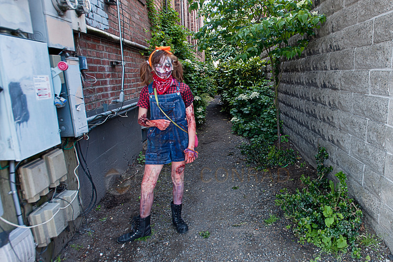 © Paul Conrad/The Bellingham Herald - Rylie Nupcharoen, 12, of Bellingham, waits to attack survivors during the fifth annual Zombies vs. Survivors on downtown Bellingham on Saturday  May 31, 2014, in Bellingham, Wash.