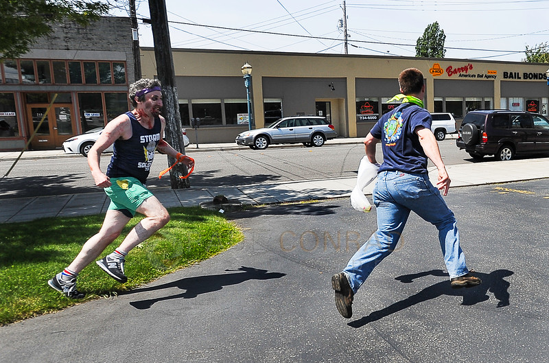 © Paul Conrad/The Bellingham Herald - Brendan Lavotz, left, chases down a surviving human during the fifth annual Zombies vs. Survivors in Downtown Bellingham, Wash.,  on Saturday  May 31, 2014. Lavotz did not catch the survivor.