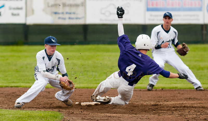 Nooksack Valley's Ryan Gelyvicks (4) begins his slide into 2nd base as Lynden Christian short stop Marc Meenderinck attempts a tag during the first inning on Saturday afternoon May 10, 2014, in Laurel,Wash., of the District 1A baseball tournament at Meridian High School. Gelyvicks was called out. Nooksack Valley defeated Lynden Christian 4-2 in seven innings.