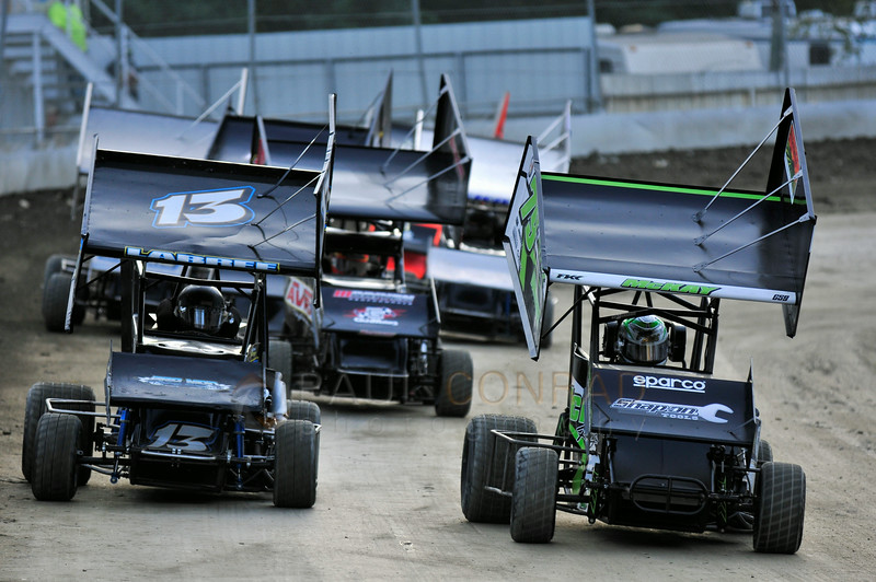 Kris Labree (13), left, and Dahnelynn McKay (79M) lead the pack as they come down the track during the 2014 Clay Cup Nationals at Deming Speedway in Everson, Wash.,  on Thursday evening July 17 , 2014. The Clay Cup Nationals mini sprint  races continue through Saturday July 19th.