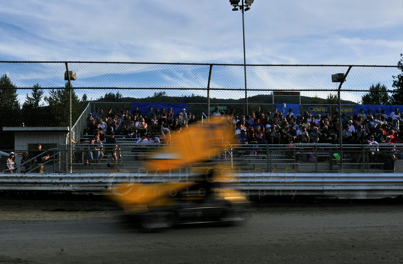 The crowds watch the qualifying races during the 2014 Clay Cup Nationals at Deming Speedway in Everson, Wash.,  on Thursday evening July 17 , 2014. The Clay Cup Nationals mini sprint  races continue through Saturday July 19th.