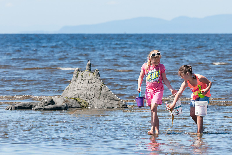 © Paul Conrad/The Bellingham Herald - Isabell Thompson and Kalia Trent, both 8, walk past Zombies after gathering supplies for their sculpture during t he 31st Annual Birch Bay Sand Sculpture Contest  on Birch Bay Beach on Saturday  morning June 14, 2014, in Birch Bay, Wash.