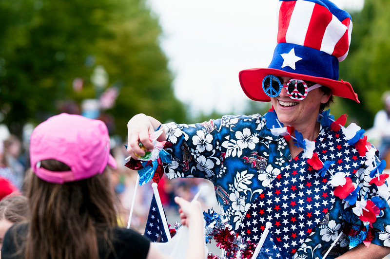 © Paul Conrad/The Bellingham Herald - Maggie Breckenridge of Blaine hands out candy during the Old Fashioned 4th of July parade in Downtown Blaine, Wash.,  on Friday July , 2014.  Thousands lined Peace Portal Drive to watch almost 100 floats pass by in this year's parade.