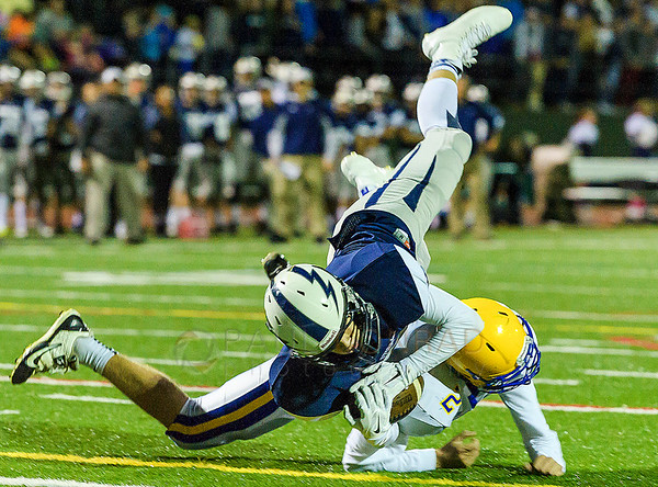 Squalicum wide receiver Noah Westerhoff (7) dives for the goal over Ferndale defensive back Sky Freeman late in the first quarter on Saturday evening Oct. 10, 2015, at Civic Field in Bellingham, Wash. Westerhoff failed to make the touchdown as time in the first quarter ran out. Squalicum failed to capitalize on their position losing the ball on downs during the first minute of the second quarter. (© Paul Conrad/The Bellingham Herald)