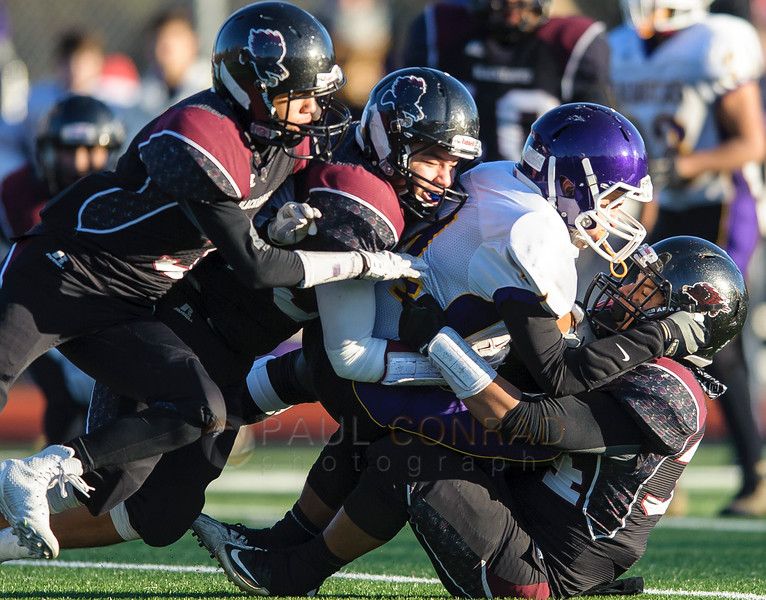 Quilcene's Acea Such (24) gets tackled by a host of Lummi defenders during the third quarter of the 1B state quarterfinals on Saturday afternoon Nov. 21, 2015, at Lummi Nation School in Lummi, Wash. Lummi went on to defeat Quilcene 40 to 0 to advance to the semi-final. (© Paul Conrad/The Bellingham Herald)