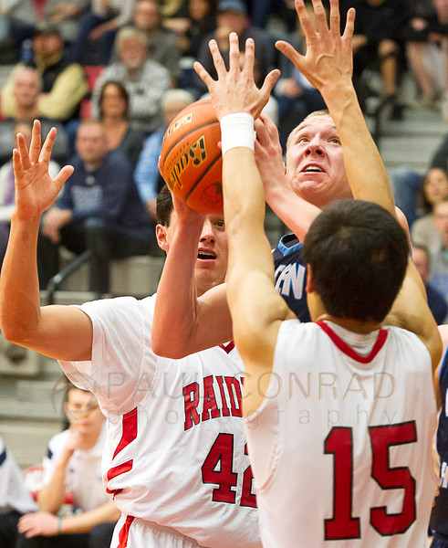 © Paul Conrad/The Bellingham Herald - Lynden Christian guard Zach Roetcisoender (31) drives between Bellingham guards Austin Shenton (42), left, and Dante Check (15) during the third quarter at Bellingham High School in Bellingham, Wash., on Monday evening Dec.15, 2014. Roetcisoender made the basket for two points with no fouls called