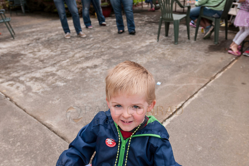 © Paul Conrad/ Pablo Conrad Photography - A boy pauses for a photo during Xindi's birthday party on Saturday afternoon May 3, 2014.