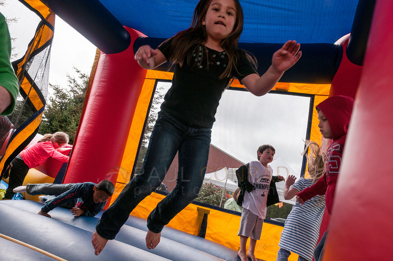 © Paul Conrad/ Pablo Conrad Photography - Kids bounce in the Bouncy Castle during Xindi's birthday party on Saturday afternoon May 3, 2014.