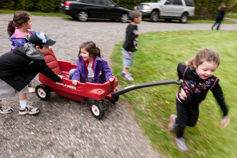 © Paul Conrad/ Pablo Conrad Photography - © Paul Conrad/ Pablo Conrad Photography - Kids zoom around on a wagon during Xindi's birthday party Xindi's birthday party on Saturday afternoon May 3, 2014.