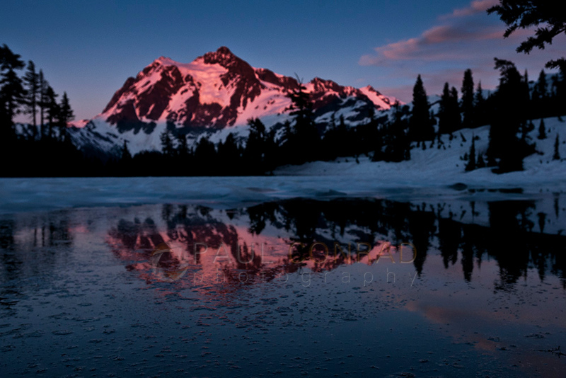 © Paul Conrad/Pablo Conrad Photography - The super perigee Moon rises over Mt. Shuksan in Whatcom County East of Bellingham, Wash., on Saturday evening June 22, 2013.This out of focus shot could have been prevented with a 10 cent piece of tape.