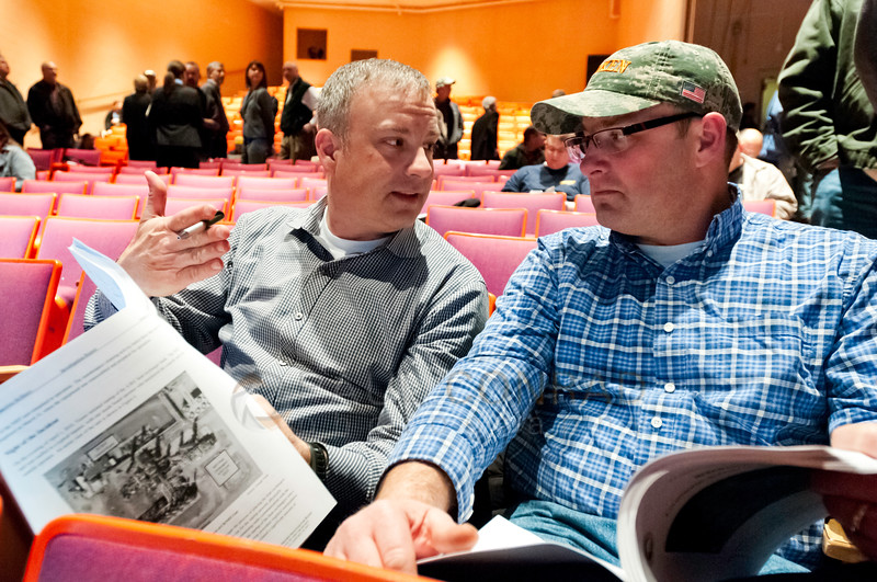 © Paul Conrad/San Antonio Express-News -  Brian Hughes of Seattle, left, and his brother Jeremy Hughes of Bellingham discuss the U.S Chemical Safety and Hazard Investigation report on Thursday evening Jan. 30, 2014, at Anacortes High School in Anacortes, Wash.. The report concerns the safety failures at the Tesoro Refinery in Anacortes which exploded and killed 7 people on April 2, 2010.