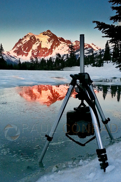 © Paul Conrad/Pablo Conrad Photography - Shooting the alpenglow on Mt. Shuksan while waiting for the rise of the super perigee Moon on Saturday evening June 22, 2013. As I liked the reflection better, I turned the center post of the tripod upside down to get my camera closer. Unfortunately, I inadvertently hit the focus ring and knocked it out of focus.