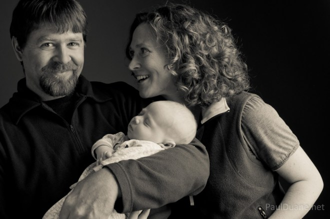 black and white portrait family with baby