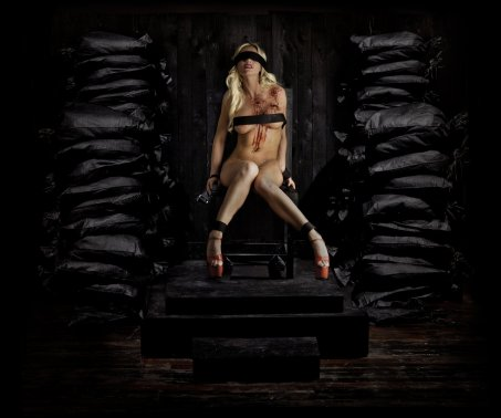 Execution by firing squad protest photo nude blonde woman