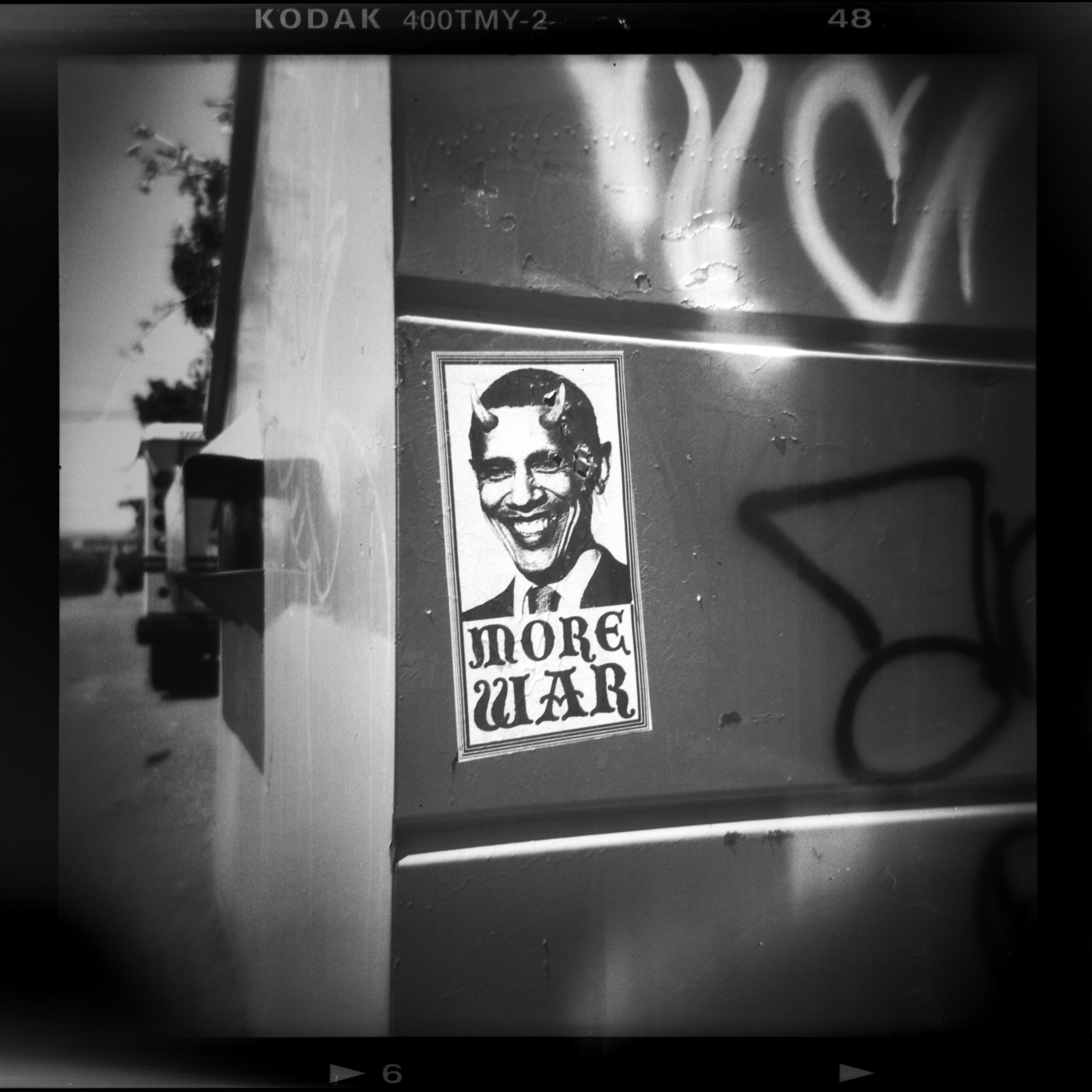 holga obama more war black and white street photography