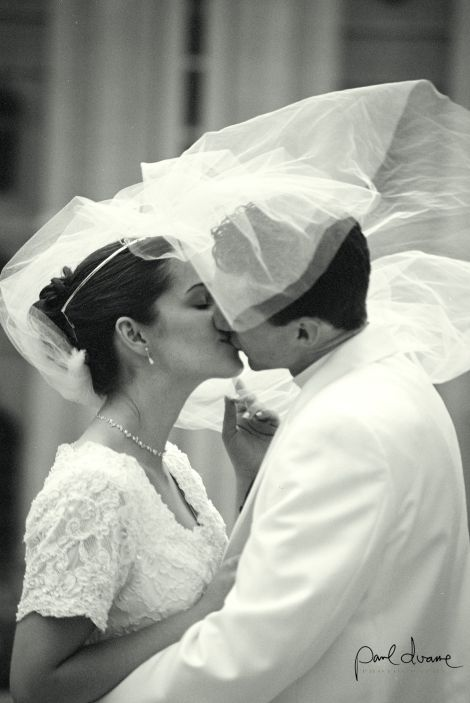 black and white bride and groom kissing