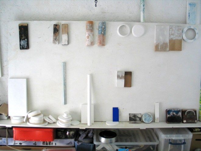 Studio with boxes, tubs and half-painted works.