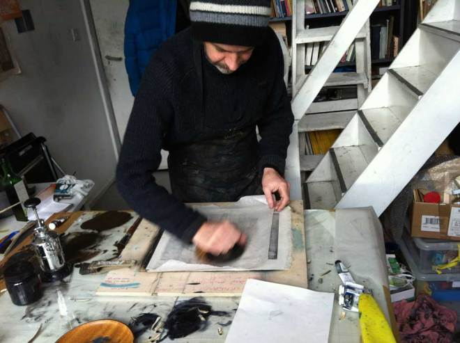 Paul printing in his studio