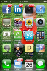 My iPhone home screen – I have mixed feelings about the little red badges