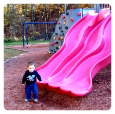 Daniel has mastered the slides at the park