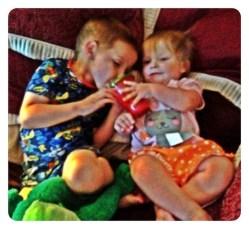 Lily giving Daniel a bottle!
