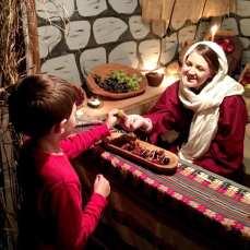 Daniel getting a grape from a merchant in Bethlehem.